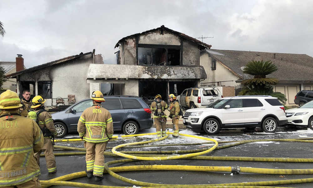 2 dead, 2 burned when plane parts hit California house