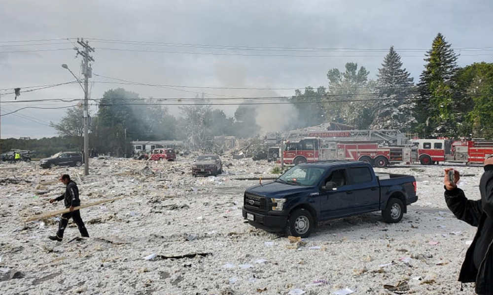 'Building is gone': Propane blast kills firefighter, hurts 6