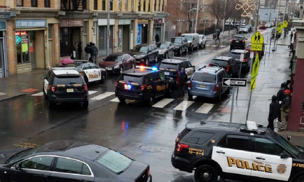 Two police officers shot as gunmen open fire in Jersey City