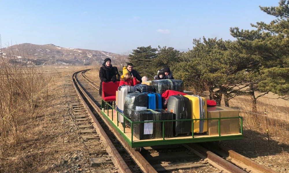 Russian diplomats push their way home with handcar out of N.Korea